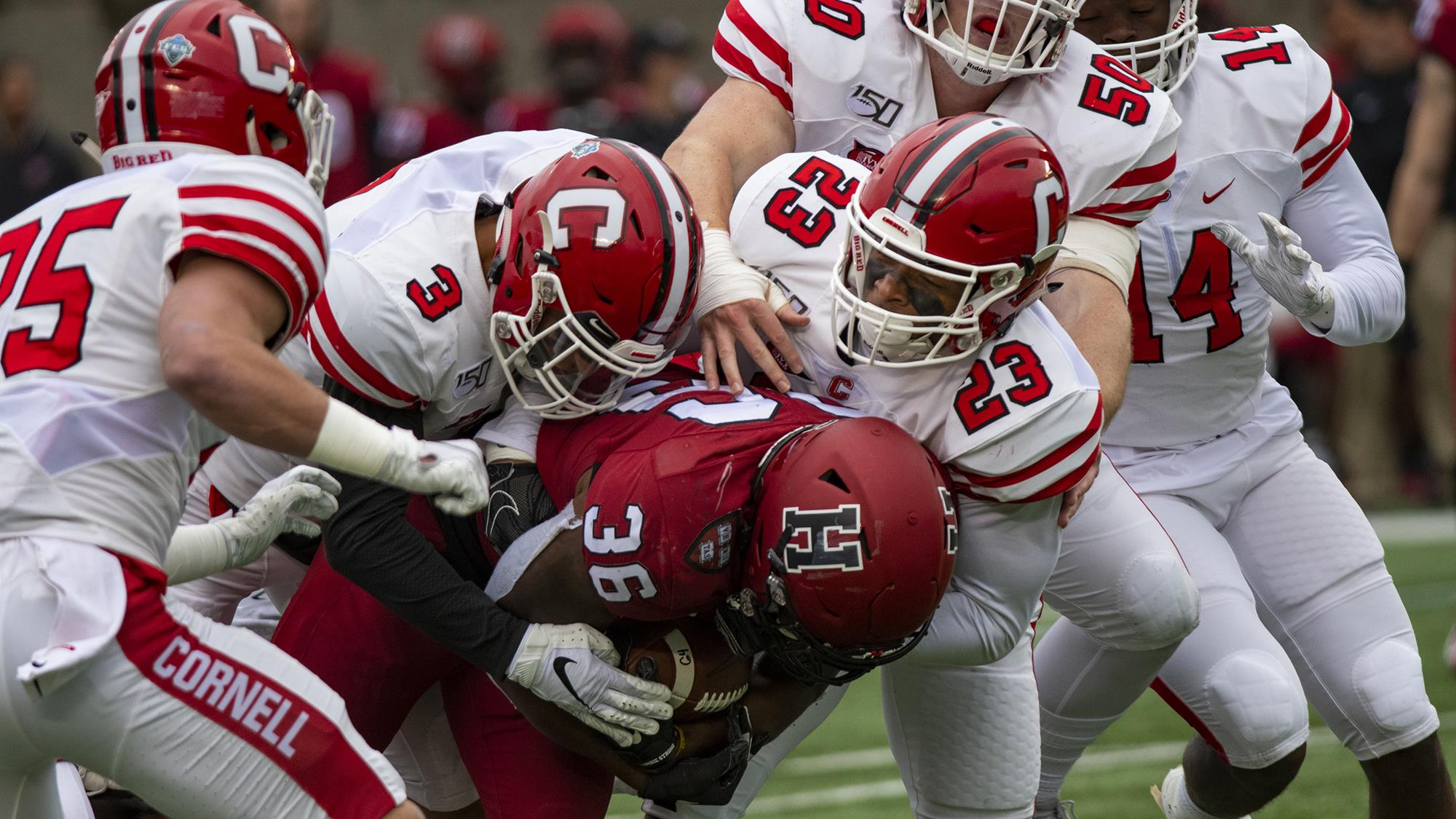 The Cornell defense, with David Jones, XXXX, Jelani Taylor, William Baker and Eric Stoxstill-Diggs in pursuit, brings down a Harvard ball-carrier during a 35-22 loss at Harvard on Saturday, Oct. 12, 2019 at Harvard Stadium in Cambridge, Mass.