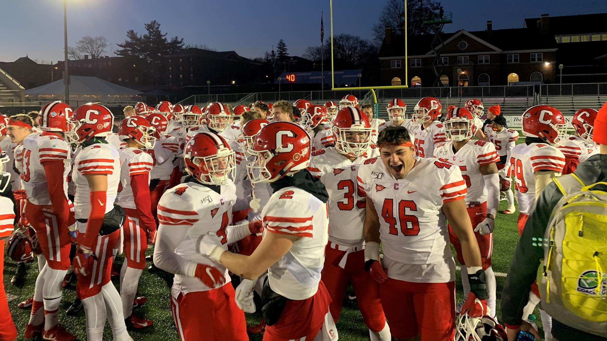 The Cornell football team celebrates on the field following its 20-17 win over No. 12 Dartmouth on Saturday, Nov. 16, 2019 at Memorial Field in Hanover, N.H.
