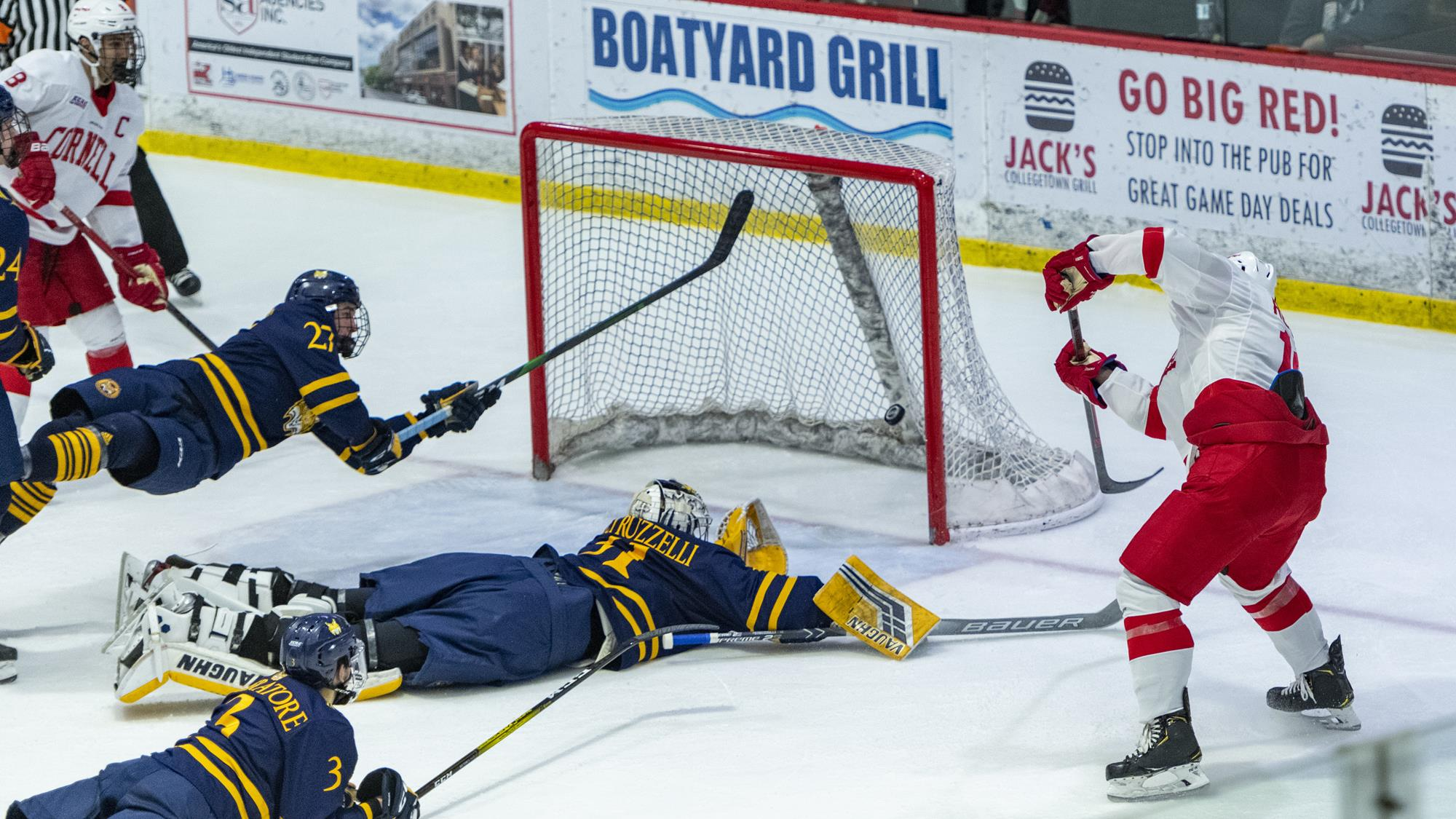 Michael Regush flips in the game-winning, power-play goal during the second period of the Cornell men's hockey team's 2-1 victory over Quinnipiac in an ECAC Hockey game on Nov. 22, 2019 at Lynah Rink in Ithaca, N.Y. (Eldon Lindsay/Cornell Athletics)
