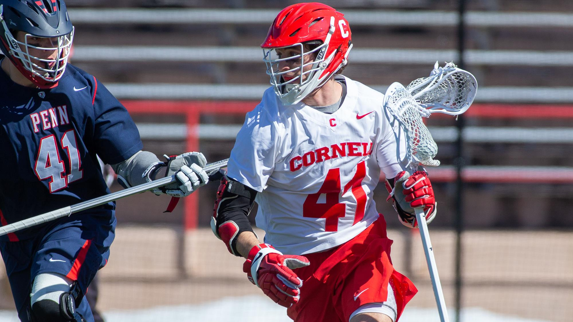 John Piatelli attacks a defender during the Cornell Big Red men's lacrosse team's contest against Penn on March 23, 2019 on Schoellkopf Field in Ithaca, N.Y.